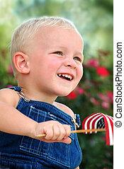 Young boy waving flag