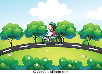 A boy riding in his bike at the street