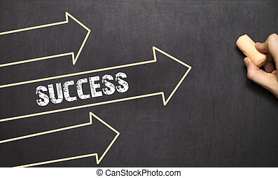 A businessman is drawing Success concept with arrows