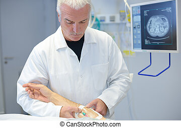 a doctor is attending patient