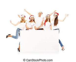 A group of happy and emotional teenagers in Christmas hats posin