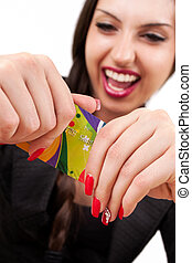 A Happy Woman holding a credit card