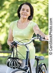 a happy woman on bike ride