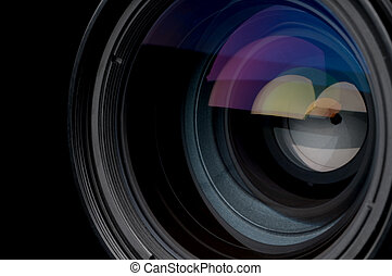 A horizontal closeup of a photographic camera lens