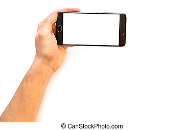 A man holding a smartphone Horizontally with white blank screen Closeup photo businessman holding hand credit card and smartphone. Online payments plastic card. Horizontal mockup.