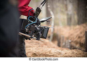 A man with camera in hand is filming