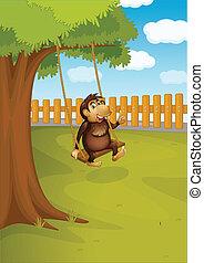 A monkey swinging on a tree