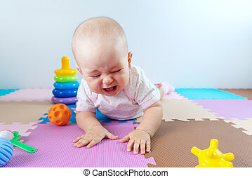 A toddler fell when trying to stand up