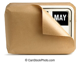 a wall clock and calendar wrapped in brown paper isolated on a white background showing May