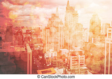 Abstract town background with blurred buildings and street, town on red tone bokeh, abstract urban details and lights