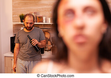 Abusive husband drinking