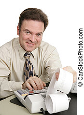 A friendly smiling accountant working on his adding machine. Isolated on white.