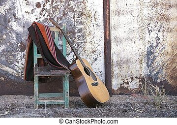 Acoustic Guitar Leaning on a Chair