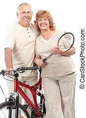 Active elderly couple. Isolated over white background