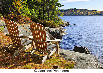 Adirondack chairs at shore of Lake of Two Rivers, Ontario, Canada