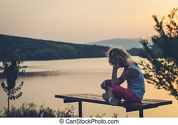 adorable child looking to the sunset