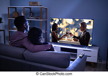 Affectionate Family Watching TV