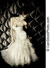 Full length portrait of a beautiful charming bride in a luxurious dress. Black-and-white.