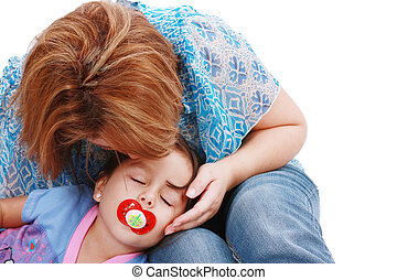 Affectionate Mother kissing her sleeping daughter