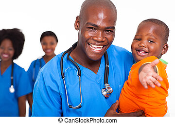 pediatric doctor playing with baby boy