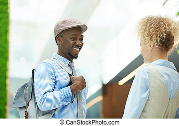African man talking to woman