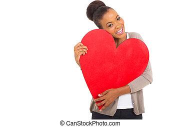 afro american woman hugging a heart shape