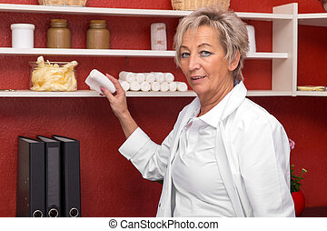 aged female doctor in her office