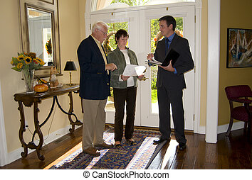 agent showing home to senior couple