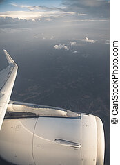 airplane wing against sky background