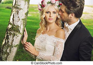Alluring bride with her handsome husband
