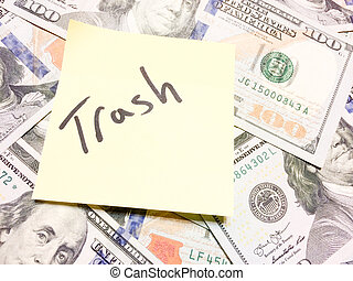 American cash money and yellow paper note with text Trash