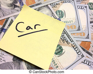 American cash money and yellow sticky note with text Car