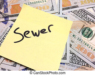 American cash money and yellow sticky note with text Sewer