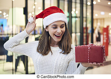 Amused woman with Christmas present