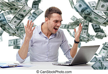 angry businessman with laptop and falling money