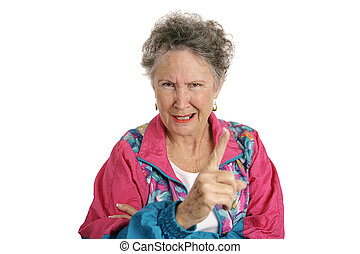 A retired senior woman in a track suit shaking her finger angrily. Isolated on white.