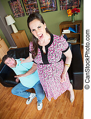 Angry Woman Grabbing Husband