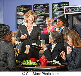Restaurant owner with group of unhappy customers