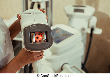 Apparatus for ultrasonic cavitation of the body in the beauty salon. Radio wave lifting of face and body