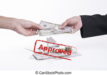 Approved mortgage loan agreement application with dollar moneyand home.