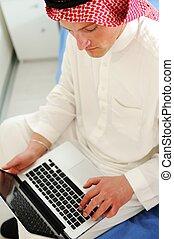 Arabic man with laptop