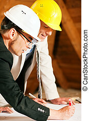 Architect and construction engineer discussing plan