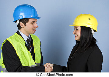 Architects conversation and shaking hands