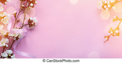 Art Amazing spring blossom; Beautiful cherry tree tender flowers on pink background.