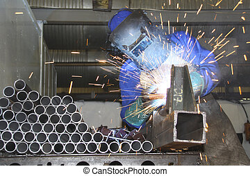 Artisan welding tubes in a production line