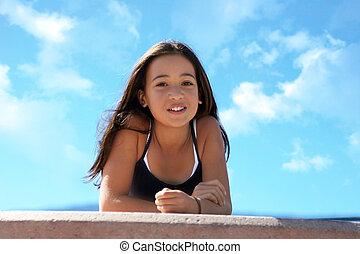 Asian teen girl against the sky