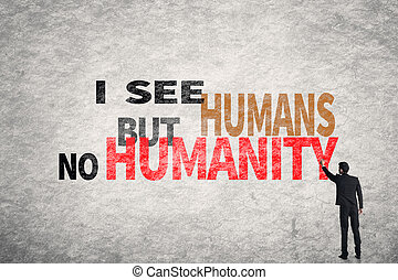 Asian businessman write text on wall, I See Humans But No Humanity