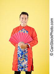 Asian man celebrating Tet