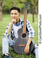Asian man with guitar