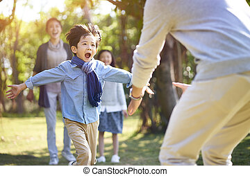 asian son running towards daddy's arms